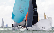 Tilt, racing in IRC class 2 (GBR7877R) leads the Belgian yacht, Alegria, on the opening day of Aberdeen Asset Management Cowes Week. The event began in in 1826 and plays a key part in the British sporting summer 'season'. It now stages up to 40 daily races for around 1,000 boats and is the largest sailing regatta of its kind in the world with 8,500 sailors competing.<br /> Picture date Saturday 2nd August, 2014.<br /> Picture by Christopher Ison. Contact +447544 044177 chris@christopherison.com