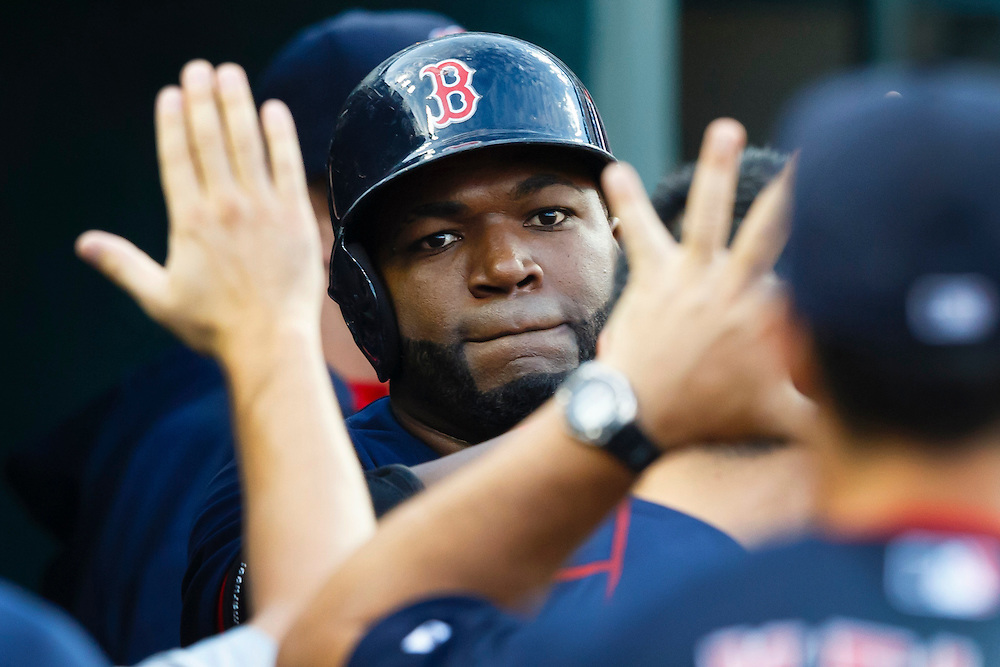 Aug 7, 2015; Detroit, MI, USA; Boston Red Sox designated hitter David Ortiz (34) receives congratulations from teammates after he hits a two run home run in the third inning against the Detroit Tigers at Comerica Park. Mandatory Credit: Rick Osentoski-USA TODAY Sports