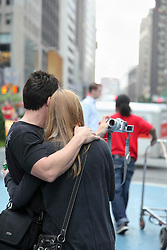 couple-in-New-York-City-taking-a-photograph-of-themselves