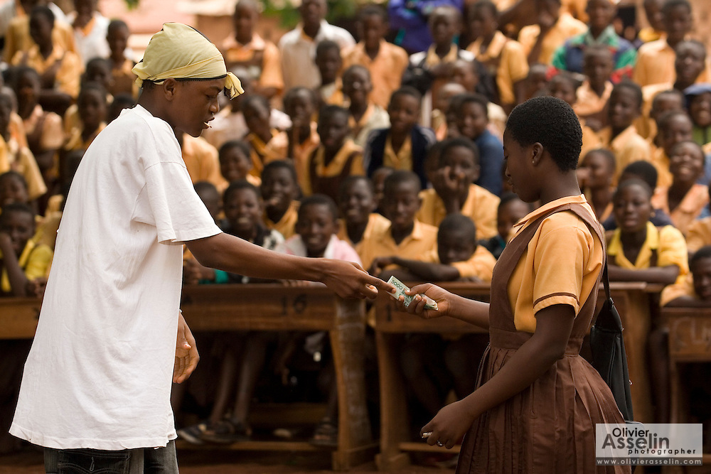 Students perform a sketch on HIV/AIDS awareness in front of other students outside the Zogbeli Junior Secondary School in Tamale, Ghana on Thursday June 7, 2007..