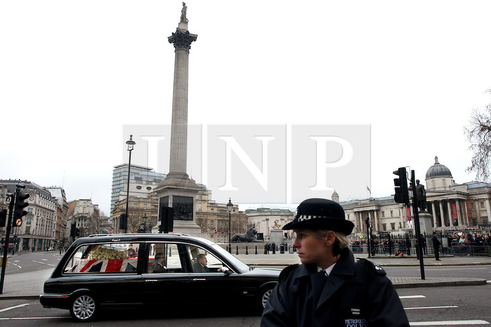 © Licensed to London News Pictures. 17/04/2013. London, UK. The body of the late Baroness Margaret Thatcher being taken by hearse at Trafalgar square on April 17, 2013 in London, England. Photo credit : Peter Kollanyi/LNP