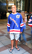 May 8, 2015 - New York, NY. A Rangers fan prepares to walk into Madison Square Garden for game 5 of the Rangers-Capitals series.  Photograph by Anthony Kane/NYCity Photo Wire