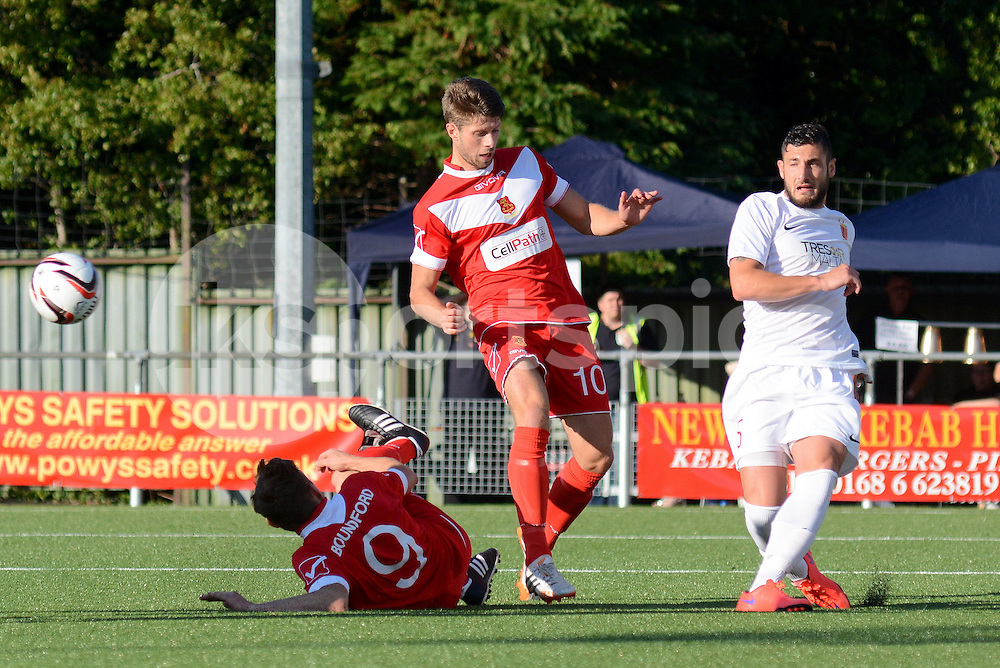 Valletta's Ryan Camilleri clears off the line from Newtown's Jason Oswell during the Europa League Qualifying match between Newtown AFC and Valletta FC at Paveways Latham Park Stadium, Newtown, Powys, Wales on 2 July 2015. Photo by Garry Griffiths.