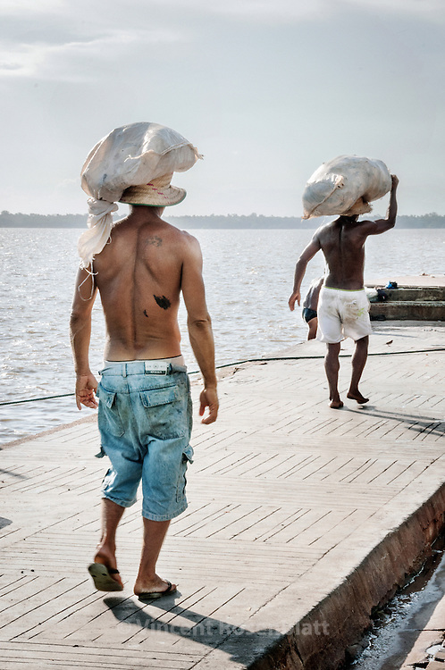 "Workers in the Ver-o-Peso fair district, in Belem - the capital of the state of Para, Amazonia . Main touristic attraction of Belem, memory of the spendor of the city "" door of Amazonia"", when rubber was the main good and wealth of the region. Guajara bay.."