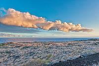 Black sand beach at sunset on Hawaii's Volcanoes National Park