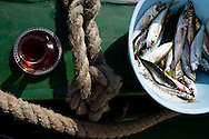 Tea and fresh fish on a fishing boat in Sinop harbour