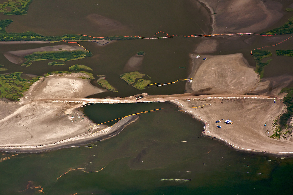 Sand berm and oil boom, Elmer's Island, Louisiana, USA. Oil patches are seen at lower left and center.