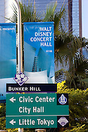 A streetside view of Los Angeles signs to civic center, city hall, little tokyo and Walt Disney Concert Hall