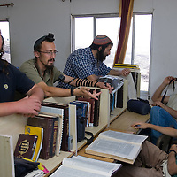 Israel settlers study at the yeshiva, talmudic school, in Havat Gilad.
