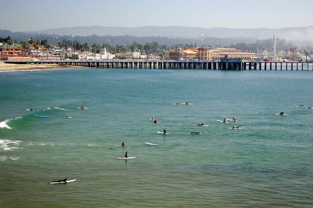 Surfer and the Santa Cruz Pier, Santa Cruz, California, United States of America