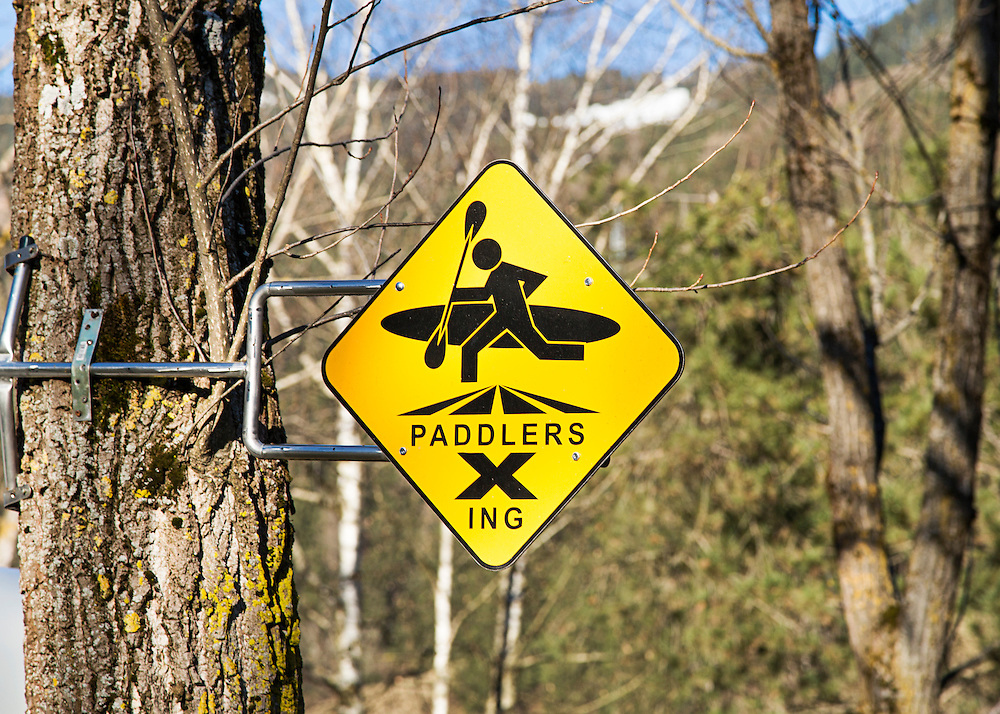 A yellow sign warning that kayakers/paddlers could be crossing