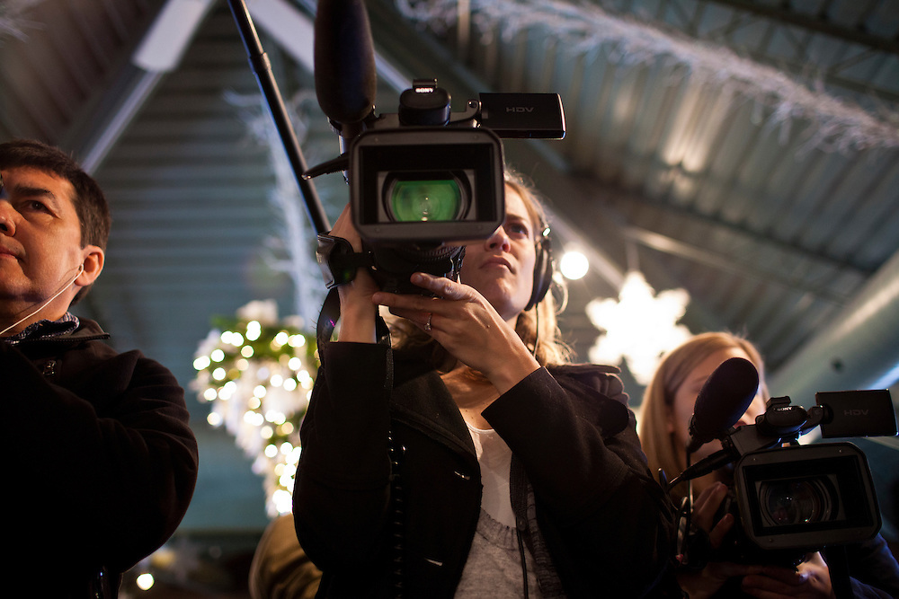 A television photographer films Republican presidential candidate Newt Gingrich at Tish's Restaurant on Saturday, December 31, 2011 in Council Bluffs, IA.