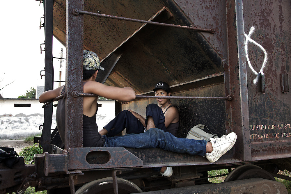 Two young migrants from Central America just arrived at Ixtepec railway station. Oxaca-Mexico,2011