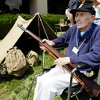 J. Harold Dumm, 95, holds an M-1 rifle, the same type he carried in the war at the final reunion for the 10th Mountain Division, the first division in the U.S. military to specialize in mountain warfare being held in Denver, Colorado August 2, 2007.  The elite division, long recognized for its major part in ending World War Two, primarily fought in Italy and Germany and is now down to 1,500 survivors out of a division of nearly 16,000. The surviving mountain soldiers range in age from 81 to over 100. Dumm was in the first group to train in the 10th Mountain at Camp Hale in Colorado.  REUTERS/Rick Wilking  (UNITED STATES)