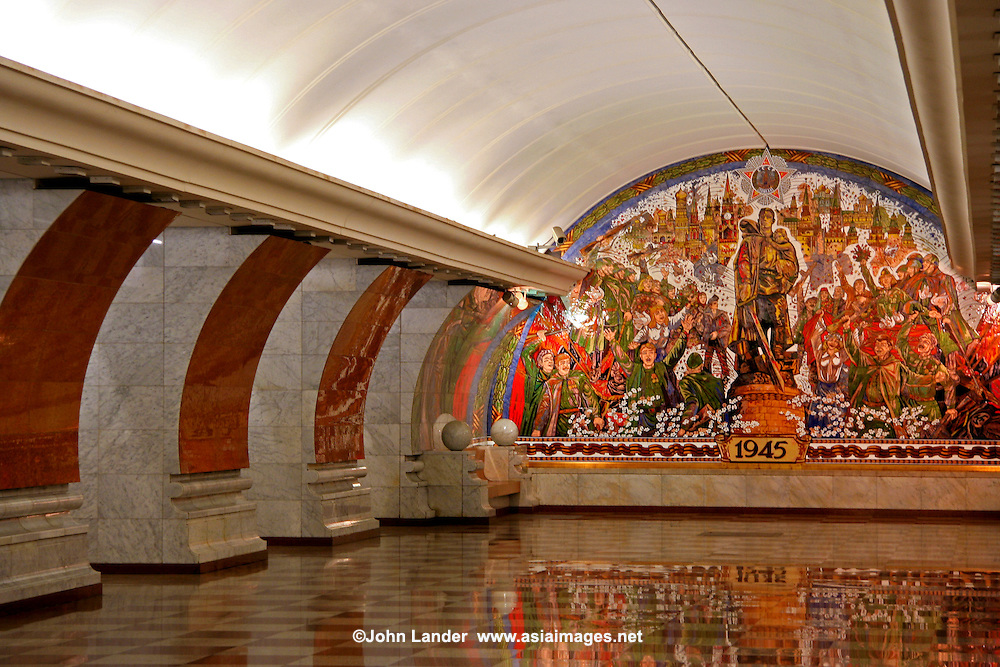 Park Pobedy Station, Moscow Metro; &quot;Victory 1945&quot; Muralist: T. Tsereteli -<br /> Park Pobedy Station or &quot;Victory Park&quot; is  84 metres underground and the deepest station on the Moscow Metro. It also contains the longest escalators in Europe, at 126 metres long and has 740 steps. The ride to the surface takes approximately three minutes.