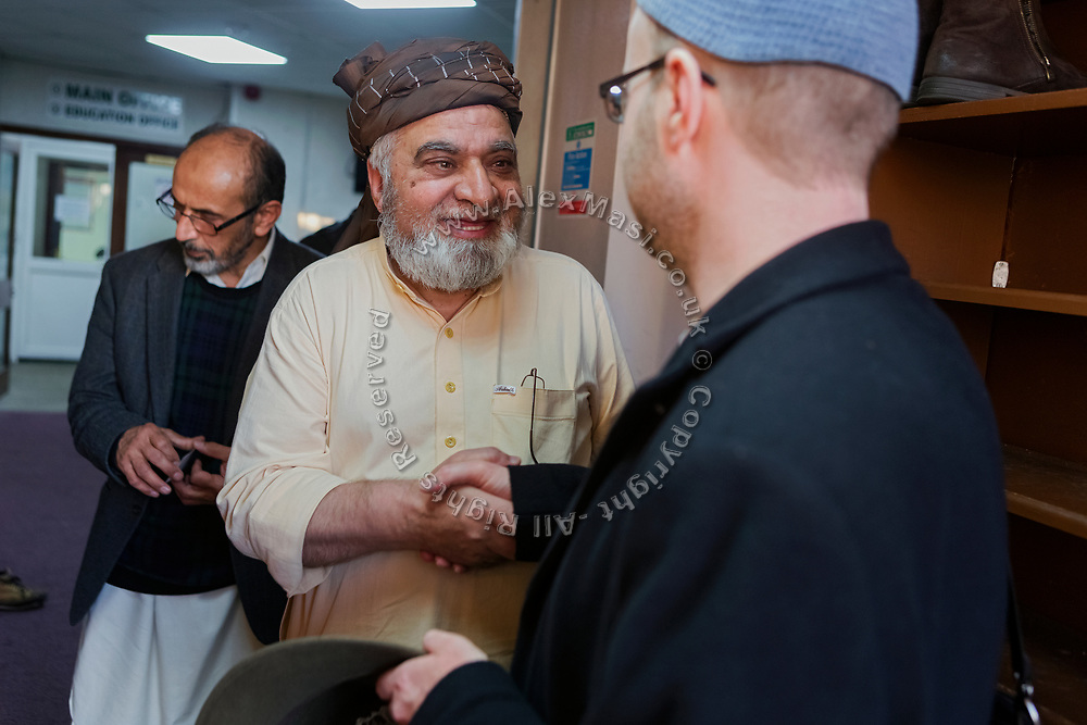 (left to right) Niaz Ahmed and Najib Bhudal, trustees of Birmingham Central Mosque, are welcoming Paul Salahuddin Armstrong, co-director of The Association of British Muslims.