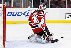 Oct 17, 2009; Newark, NJ, USA; New Jersey Devils goalie Martin Brodeur (30) makes a save during the first period of their game against the Carolina Hurricanes at the Prudential Center.