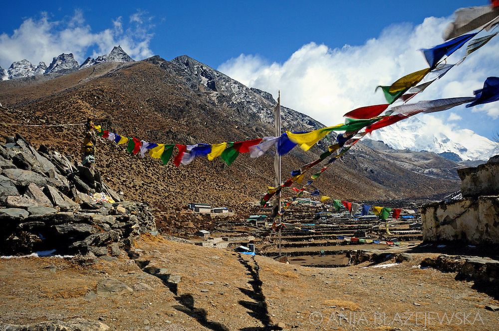 Nepal, Dingboche. Praying flags over Dingboche - one of the highest situated mountain villages.