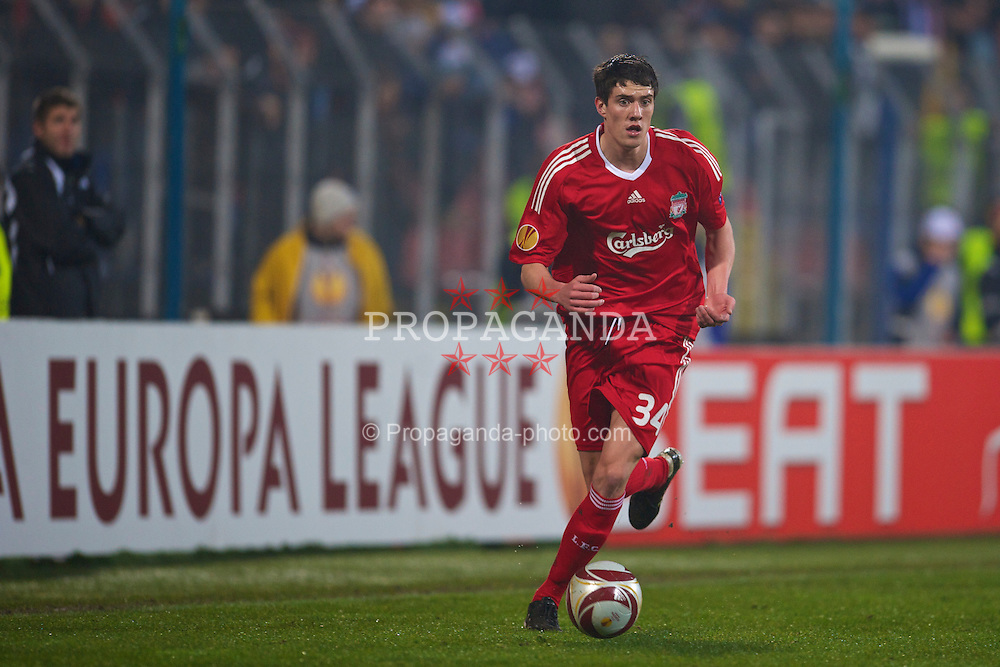 BUCHAREST, ROMANIA - Thursday, February 25, 2010: Liverpool's Martin Kelly in action against FC Unirea Urziceni during the UEFA Europa League Round of 32 2nd Leg match at the Steaua Stadium. (Photo by David Rawcliffe/Propaganda)
