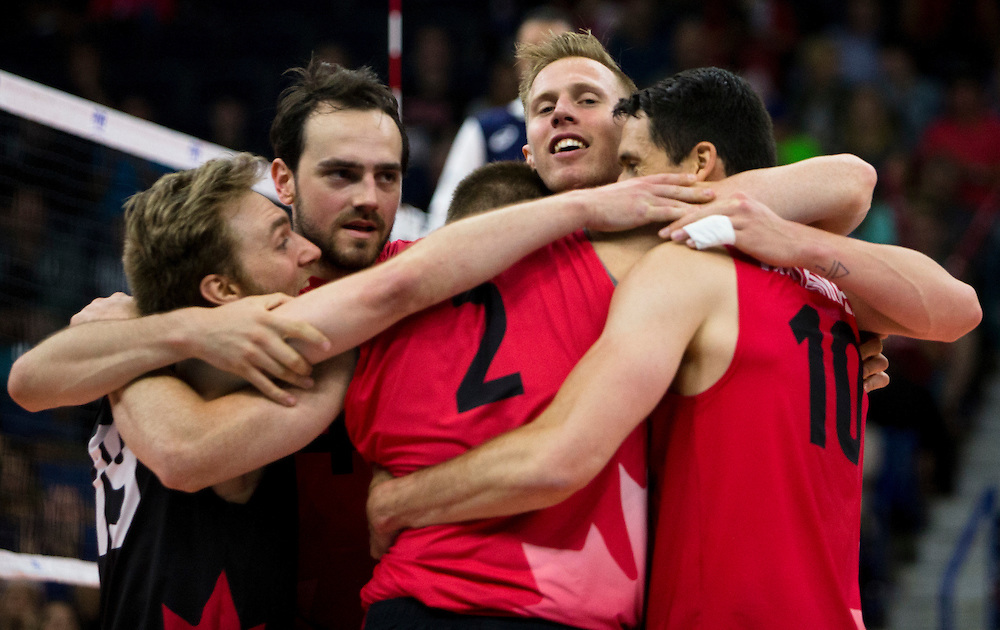 Daniel Cornelius Jansen Vandoorn (11) and Nicholas Hoag (4) celebrate a winning point for Canada versus Portugal during a World League Volleyball match at the Sasktel Centre in Saskatoon, Saskatchewan Canada on June 26, 2016.