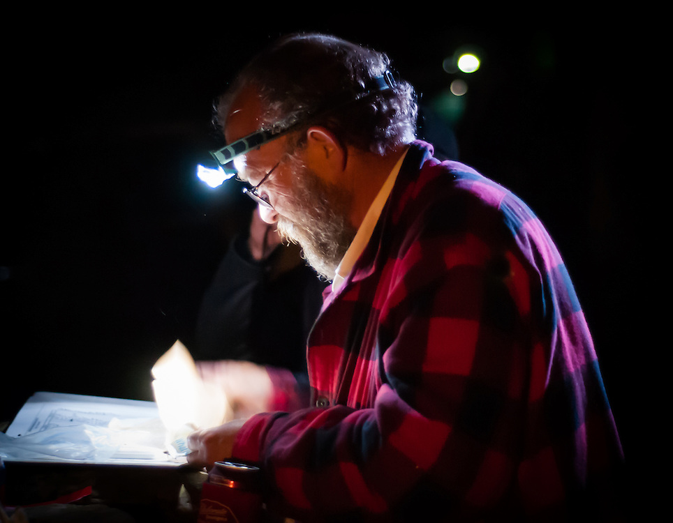 Laz counts pages by headlamp during the Barkley Marathons.
