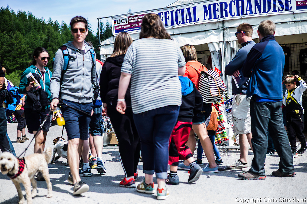 Nevis Range, Fort William, Scotland, UK. 4th June 2016. Crowds attend walk past the offical merchandise stall as the worlds leading mountain bikers descend on Fort William for the UCI World Cup on Nevis Range.