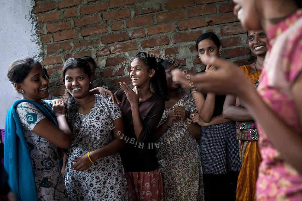 Mayuri Mahesh Pandit, 13, (centre) is participating to the Unicef-run 'Deepshikha Prerika' project inside the Milind Nagar Pipeline Area, an urban slum on the outskirts of Mumbai, Maharashtra, India, where she resides with her family.