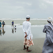 Two young men, watching the sea on Cox's Bazar's beach, Bangladesh