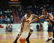 "Ole Miss' Jarvis Summers (32) vs. SMU's London Giles (11) at the C.M. ""Tad"" Smith Coliseum in Oxford, Miss. on Tuesday, January 3, 2012. Ole Miss won 50-48."