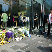 BEIJING, OCT. 6 : Flowers and  a picture of Steve Jobs are placed outside the Apple Store in Beijing in memorial for Steve Jobs .