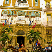 A horse drawn carriage pases the luxurious Hotel Sevilla in Havana, Habana, Cuba.