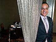 Restauranteur Ashok Bajaj poses for a portrait in his restaurant Bibiana in Washington, DC, September 16, 2009.