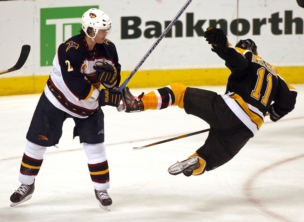(02/26/07- Boston, MA) Bruins vs Atlanta Thrashers. Bruin P.J Axelsson gets thrashed by Thrasher Garnet Exelby in 2nd period action..Staff photo by Mark Garfinkel