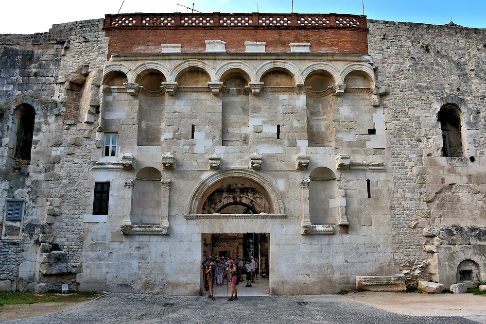 Golden Gate of Diocletian&rsquo;s Palace in Split, Croatia<br /> The Golden Gate was the primary portal into Diocletian&rsquo;s Palace when the retired Roman Emperor lived here in the early 4th century.  Notice the empty niches on the fa&ccedil;ade of the Porta Aurea.  These once housed grand statues including one of Emperor Diocletian. This is the outer gate.  It leads to a 30 by 30 foot courtyard where there is a second gate into the northern section of Old Town.