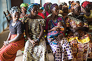A group of local women attend a sssion from the  Social mobilisation team talk in Lester road about promoting health and facilitating community acceptance of new surveillance, clinical care, and burial procedures in Freetown. 22 Decembre 2014