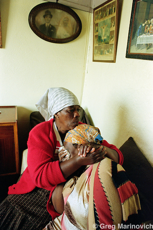 Meadowlands, Soweto, Johannesburg, South Africa. 26 April 1992. A family mourns the death of a family member in political violence.