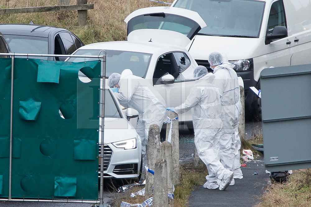 © Licensed to London News Pictures. 03/01/2017. Huddersfield UK. Picture shows Police Forensic officers at the scene where a man has died during a pre-planned operation on a M62 slip road near Huddersfield. Police said a police firearm was discharged at about 18:00 on Monday near the M62 motorway.  Photo credit: Andrew McCaren/LNP