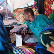 A member of a refugee family in a makeshift tent at the Mbera camp for Malian refugees in Mauritania on 2 March 2013.