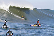 Carlos Burle drops into a huge wave at the 2010 Mavericks Surf Contest - Half Moon Bay, California