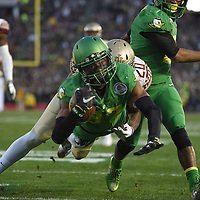ORIG 01/01/2014 Ryan Brennecke / The Bulletin<br /> <br /> Darren Carrington dives into the end zone to score during the third quarter of the Rose Bowl against Florida on Thursday.
