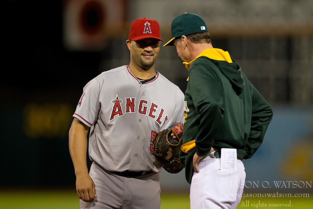 OAKLAND, CA - SEPTEMBER 23:  Albert Pujols #5 of the Los Angeles Angels of Anaheim talks to Bob Melvin #6 of the Oakland Athletics during the fourth inning at O.co Coliseum on September 23, 2014 in Oakland, California. The Los Angeles Angels of Anaheim defeated the Oakland Athletics 2-0.  (Photo by Jason O. Watson/Getty Images) *** Local Caption *** Albert Pujols; Bob Melvin