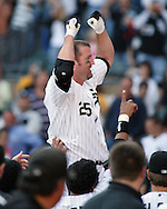 CHICAGO - SEPTEMBER 16:  Jim Thome #25 of the Chicago White Sox celebrates after hitting his 500th career home run, a walk off home run winning the game, off of Dustin Moseley #58 during the game against the Los Angeles Angels at U.S. Cellular Field in Chicago, Illinois on September 16, 2007.  The White Sox defeated the Angels 9-7.  (Photo Credit Ron Vesely)