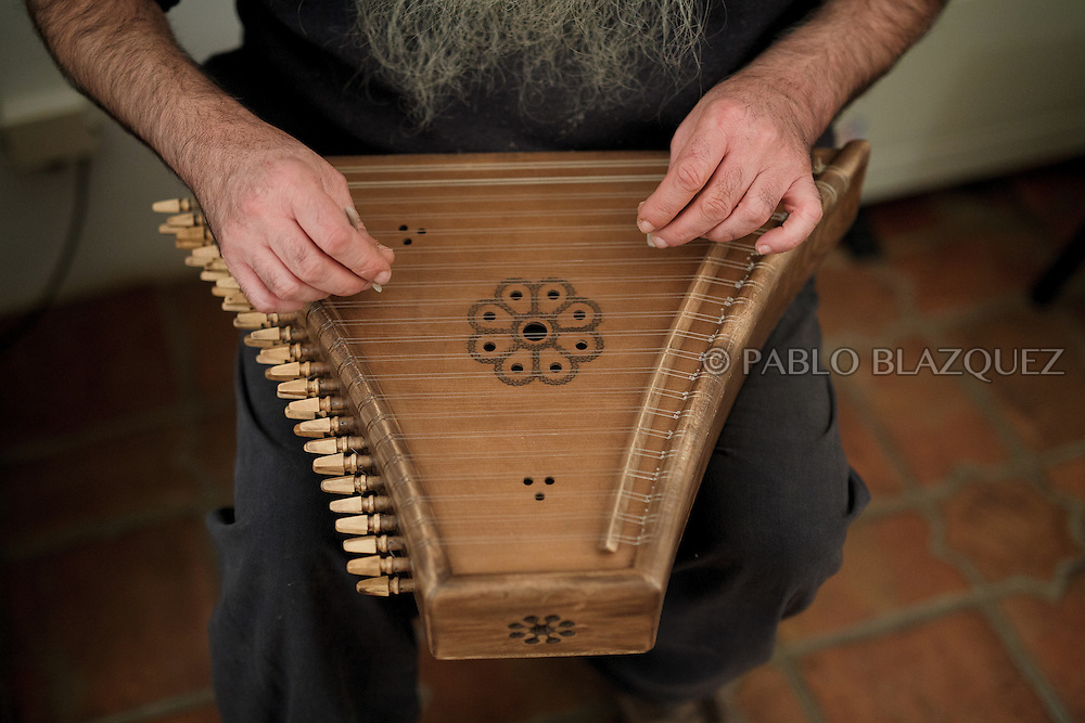 02/12/2016. Jesus Reolid plays a psaltery during an exhibition of musical instruments from medieval times recently made by luthiers at the Santa María la Real de Valdeiglesias Monastery on December 2, 2016 in Pelayos de la Presa, Madrid province, Spain. The Collegiate of Santa María la Mayor is a Romanesque architecture church built during the 12th and 13th centuries. Recents restorations of the Church discovered many details on its sculptures. Then luthiers started the project 'De la piedra a la madera' to recover and to reproduce the instruments displayed on the North Gate. (© Pablo Blazquez)