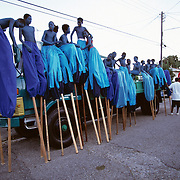 "Trinidad and Tobago ""MOKO JUMBIES: The Dancing Spirits of Trinidad"".A photo essay about a stilt walking school in Cocorite, Trinidad..Dragon Glen de Souza founded the Keylemanjahro School of Art & Culture in 1986. The main purpose of the school is to keep children off the streets and away from drugs..He first taught dances like the Calypso, African dance and the jig with his former partner Cathy Ann Samuel.  Searching for other activities to engage the children in, he rediscovered the art of stilt-walking, a tradition known in West Africa as the Moko Jumbies , protectors of the villages and participants in religious ceremonies. The art was brought to Trinidad by the slave trade and soon forgotten..Today Dragon's school has over 100 members from age 4 and up..His 2 year old son Mutawakkil is probably the youngest Moko Jumbie ever. The stilts are made by Dragon and his students and can be as high as 12-15 feet. The children show their artistic talents mostly at the annual Carnival, which today is unthinkable without the presence of the Moko Jumbies. A band can have up to 80 children on stilts and they have won many of the prestigious prizes and trophies that are awarded by the National Carnival Commission. Designers like  Peter Minshall , Brian Mac Farlane and Laura Anderson Barbata create dazzling costumes for the school which are admired by thousands of  spectators. Besides stilt-walking the children learn the limbo dance, drumming, fire blowing and how to ride  unicycles..The school is situated in Cocorite, a suburb of Port of Spain, the capital of Trinidad and Tobago..all images © Stefan Falke"