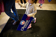 A young supporter carries a sign at a campaign rally with Sen. Barack Obama (D-IL) in Exeter, N.H., on Sunday, Jan. 6, 2008.