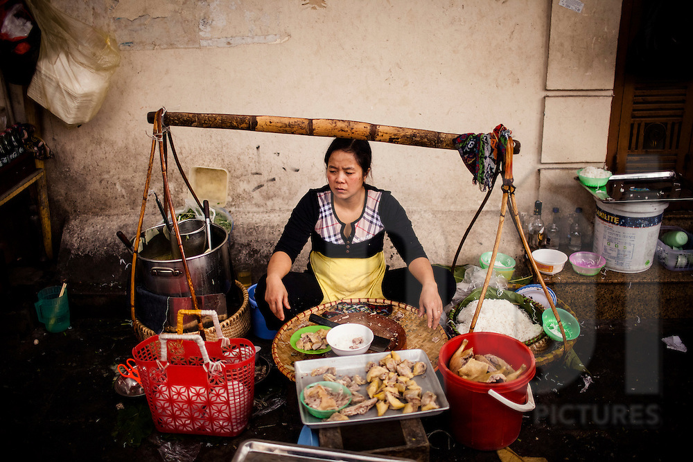 Portrait of a street noodle vendor in Hanoi, Vietnam, Southeast Asia