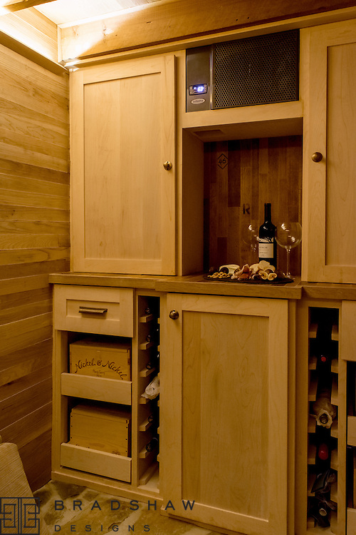 Surprise! Wine cellar created from previously hidden storm cellar. Relax and enjoy!