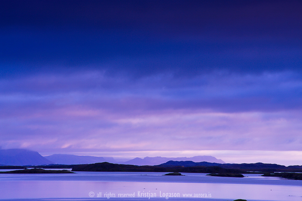 Blue light atmidnight over the Islands of Breidafjordur bay in west Iceland