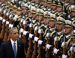 epa04485887 US President Barack Obama (L) reviews honor guards during a welcome ceremony at the Great Hall of the People (GHOP) in Beijing, China, 12 November 2014. Obama is in China to attend the Asia-Pacific Economic Cooperation (APEC) 2014 Summit and related meetings.  EPA/HOW HWEE YOUNG