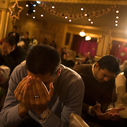 Students are seen praying as Amr Khaled, an Islamic televangelist, leads his followers at a Life Makers gathering inside a local wedding hall, Alexandria, Egypt, Dec. 24, 2005. Khaled had previously been asked to leave Egypt as his revival gained strength. As a result he started preaching on several television shows, turning him into an international celebrity. Some religious scholars complain that Khaled has not been properly trained in Islam to command such a following.